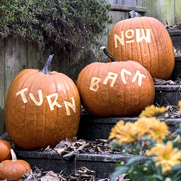 halloween restaurant promotions: place message carved pumpkins near your main entrance