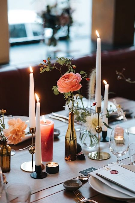 table setting featuring flowers and candles